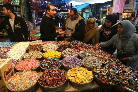 Palestinians buy sweets in the West Bank